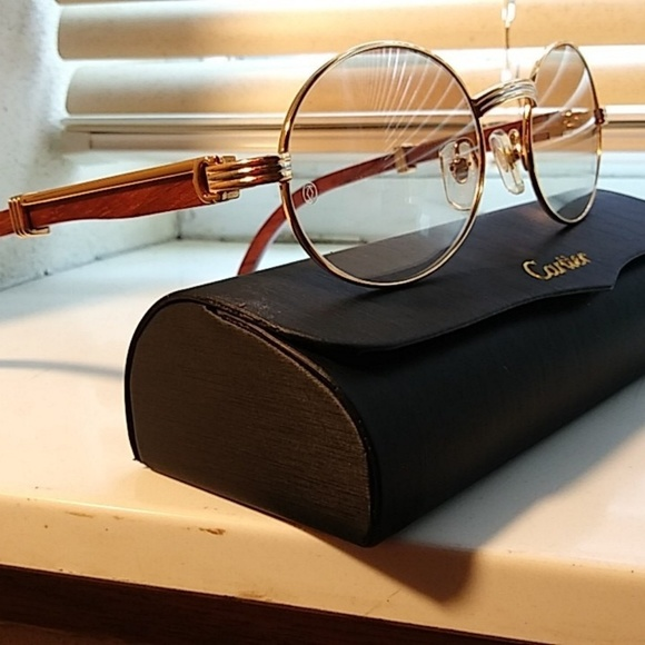 3d3e99dd3cc7 Cartier Other - Cartier oval vintage gold with wood frames.